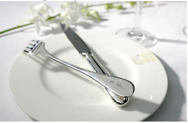 Mr Chow signature plate and cutlery